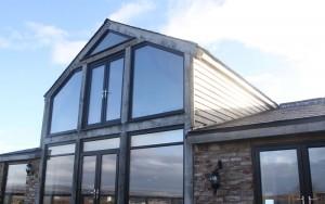 Bespoke angled windows in grey