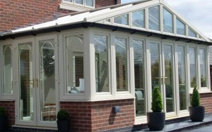 Gable front conservatory in white with brick base
