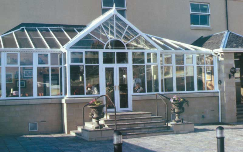 White t-shape conservatory with gable front