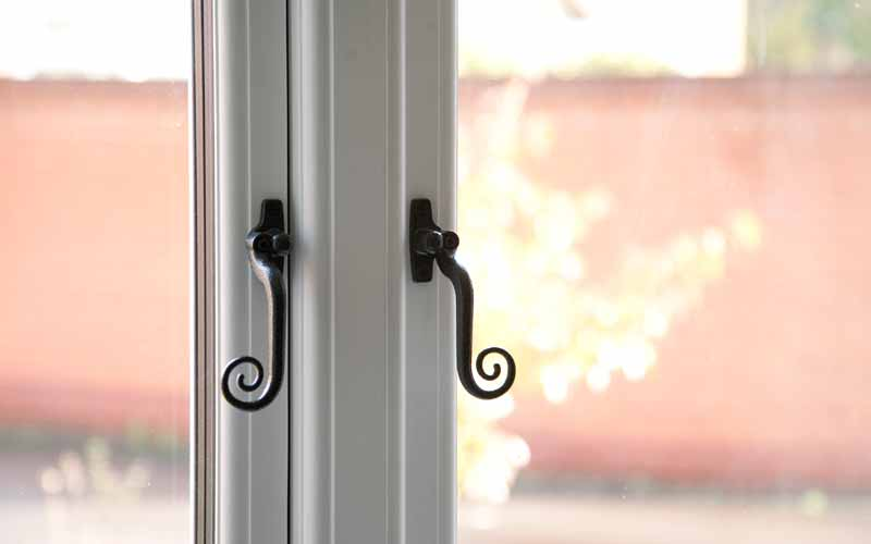 Mock timber windows with traditional handles