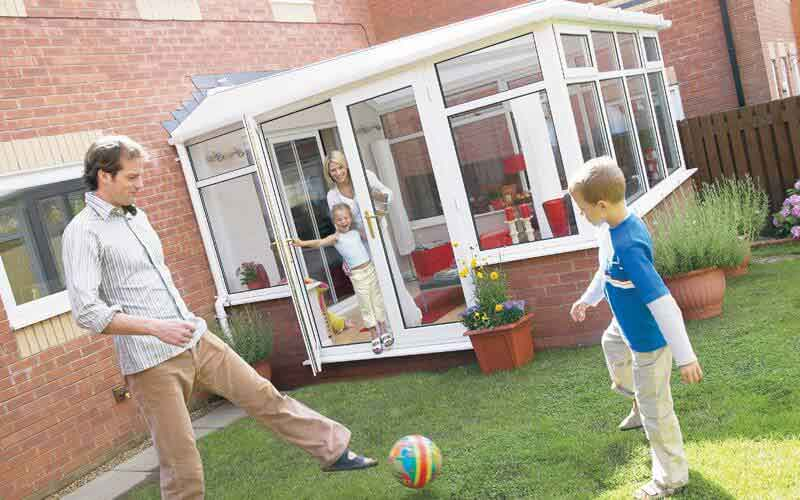 Lean to conservatory with family outside