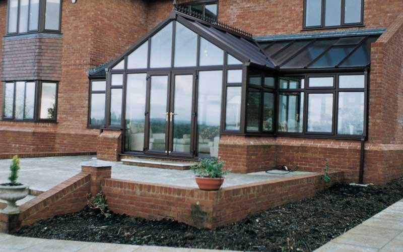T shape conservatory in brown