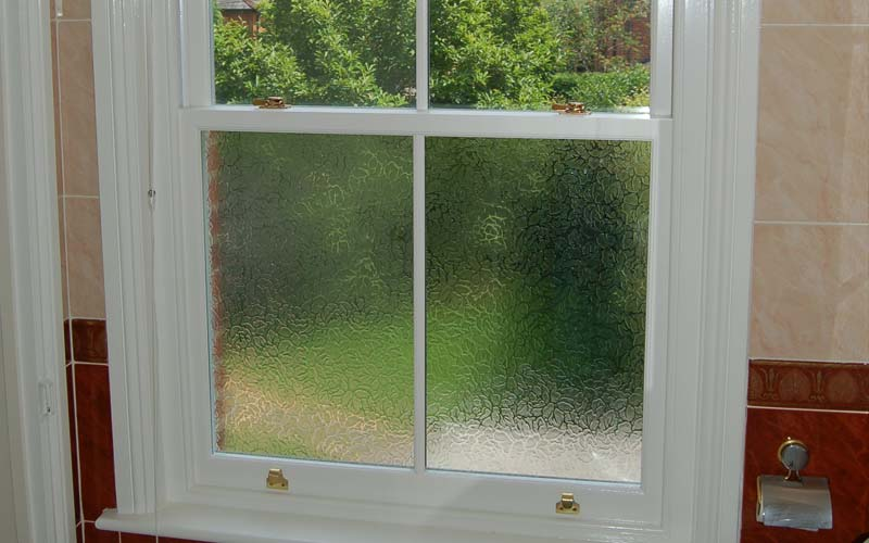 Timber windows - sliding sash style with privacy glass