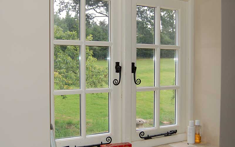 Traditional hardwood windows painted white